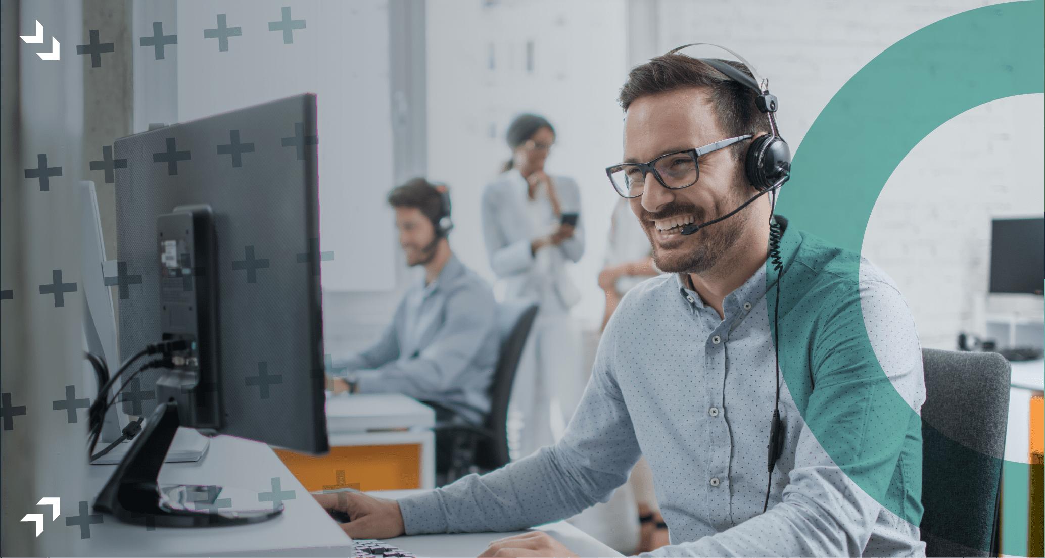 Man wearing headset, sat at a desk