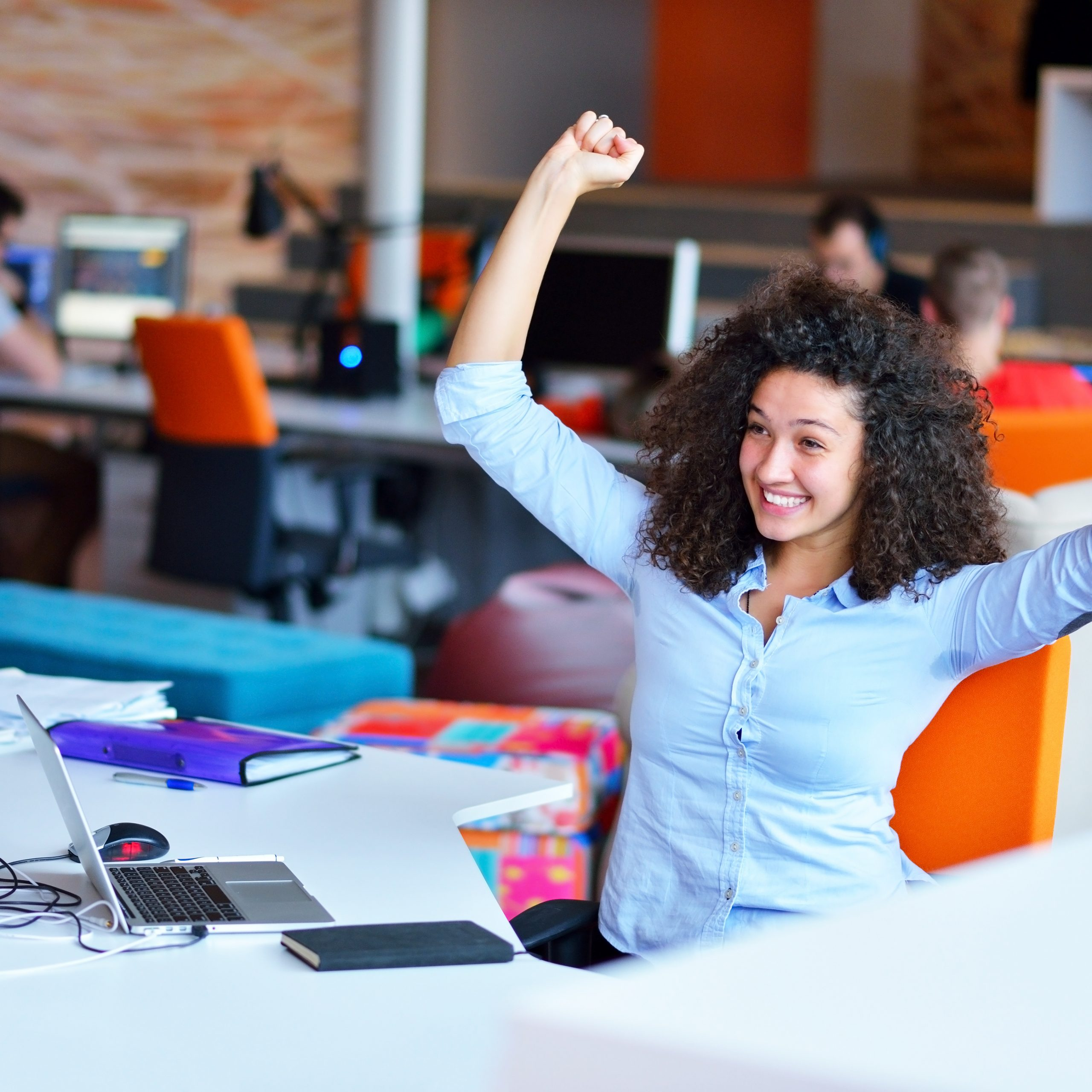woman girl cheering at desk shutterstock_226373764 (2)